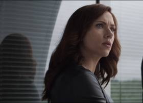 As Natasha prepares to leave Tony's side, we can see her reflection behind her. She still wants to bring both sides together.