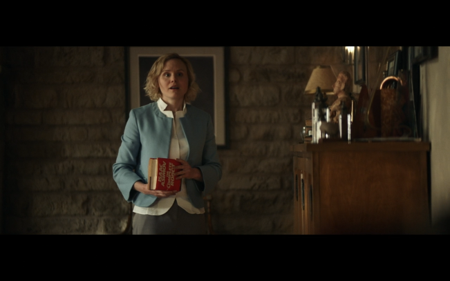 Star Trek Picard S1E2 Agnes Visits Chateau Picard Wearing Her Little Blue Coat and Holding Red Asimov