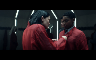 Star Trek Picard S1E2 Soji Helps Colleague with Red Hazard Suit and Badge on the Artifact