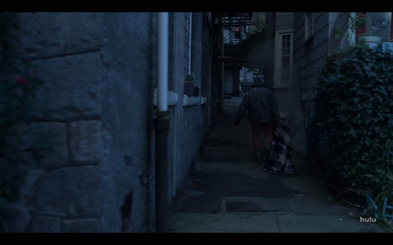 Helstrom S1Ep2 Man Drags Checked Blanket in Alley