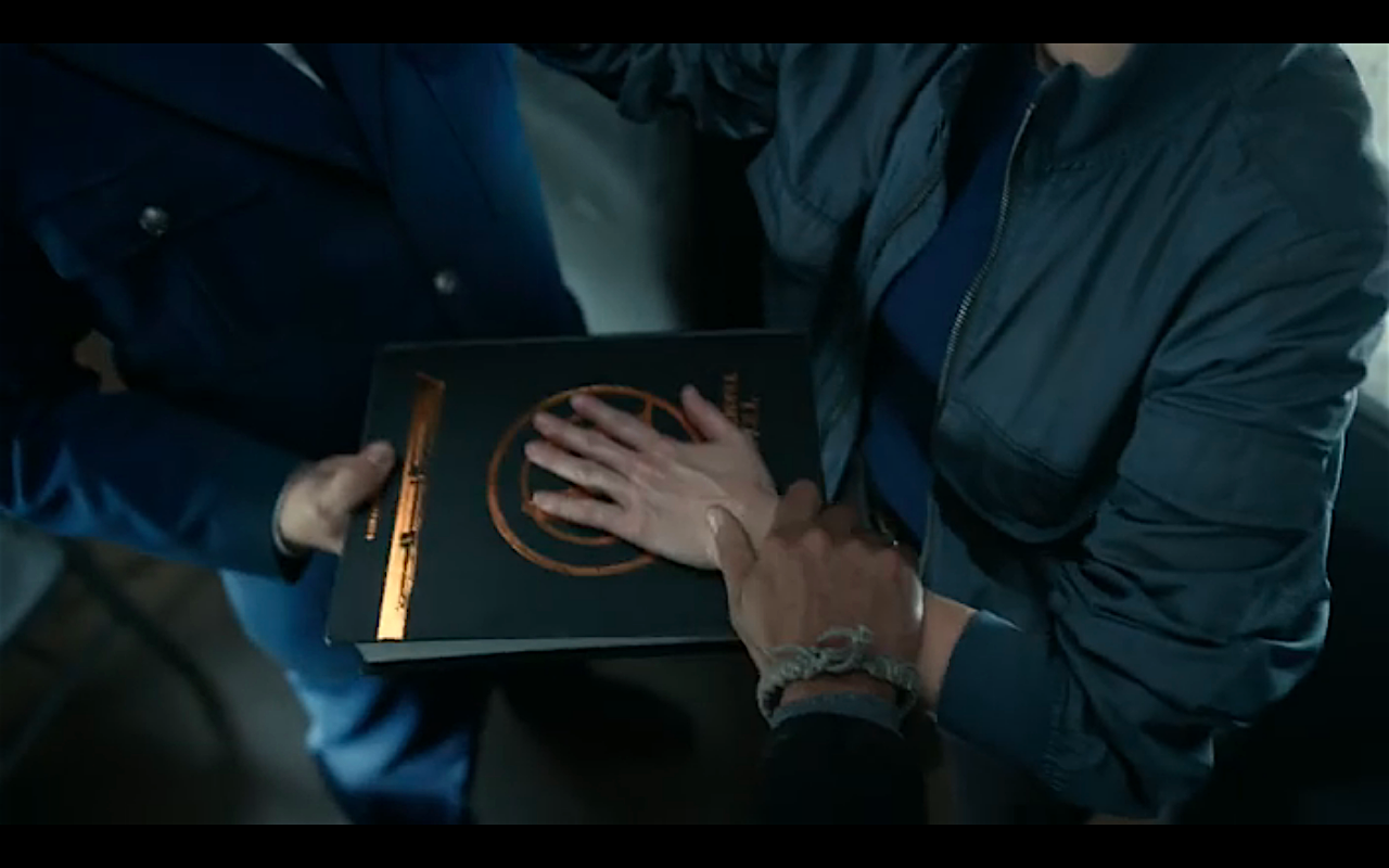 Snowpiercer S2Ep2 Bess' Hand on Wilford's Bible