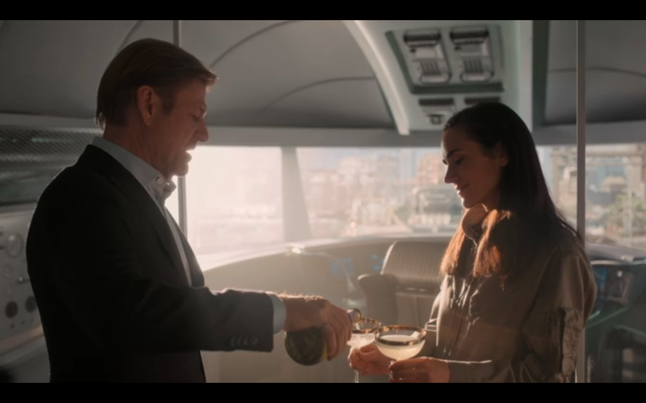 Snowpiercer S2Ep6 Wilford Pours Champagne for Melanie