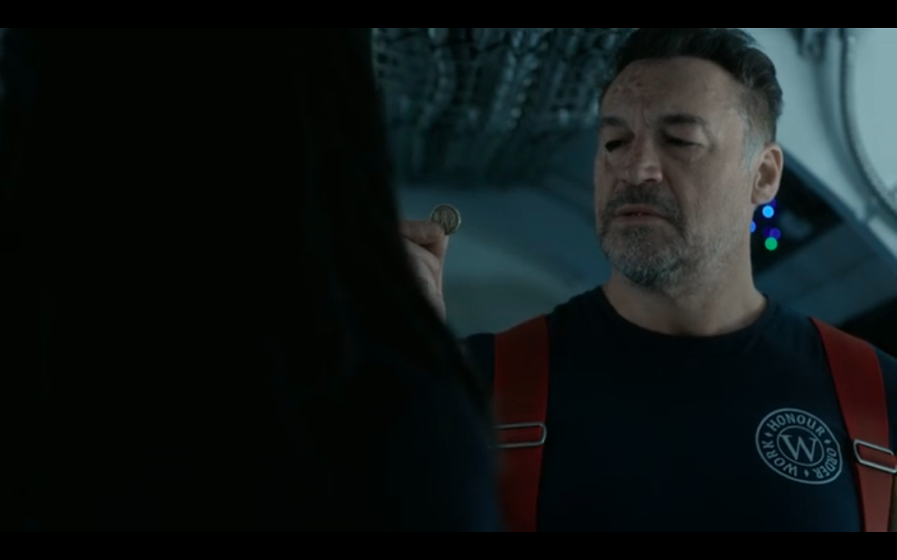 Snowpiercer S2Ep8 Boki with Breachman's Wilford Coin