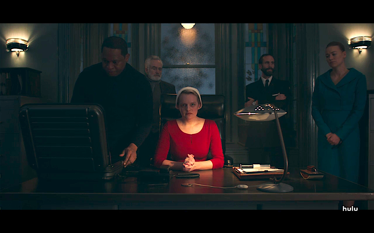 Handmaid's Tale S3Ep5 June at Lawrence's Desk